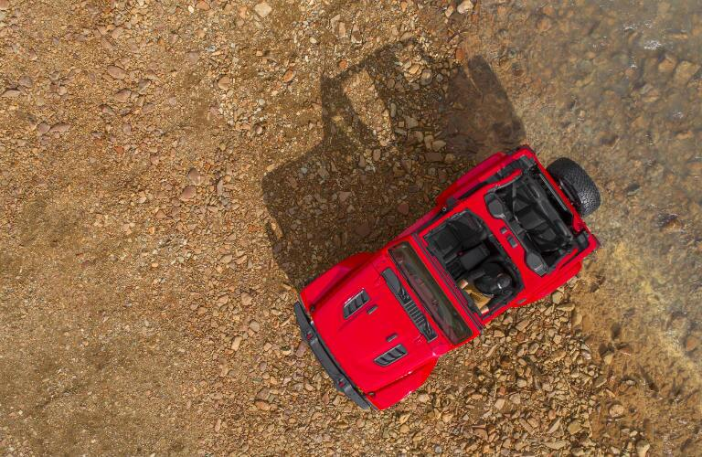 overhead view of a red 2018 Jeep Wrangler with the roof off