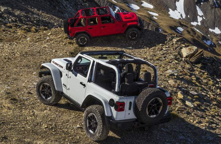 white and red all-new 2018 Jeep Wrangler parked on rocks