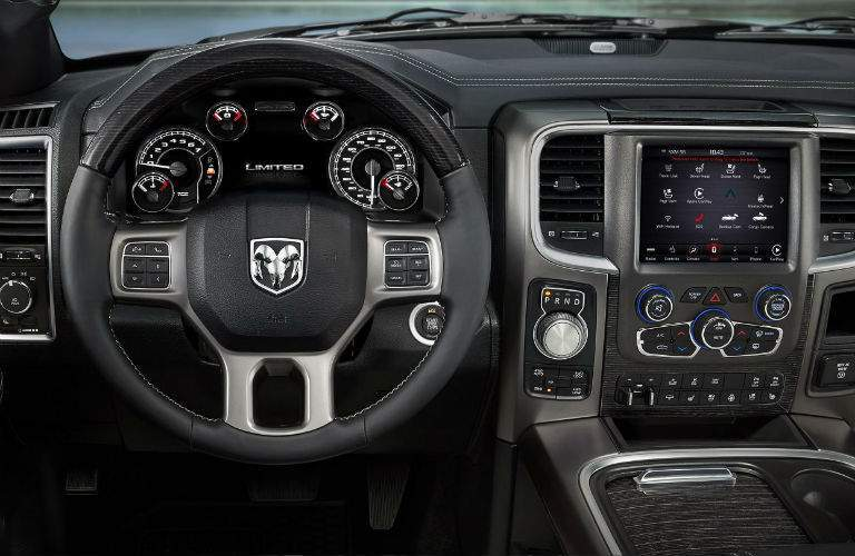 Ram steering wheel and Uconnect infotainment system in the 2018 Ram 1500