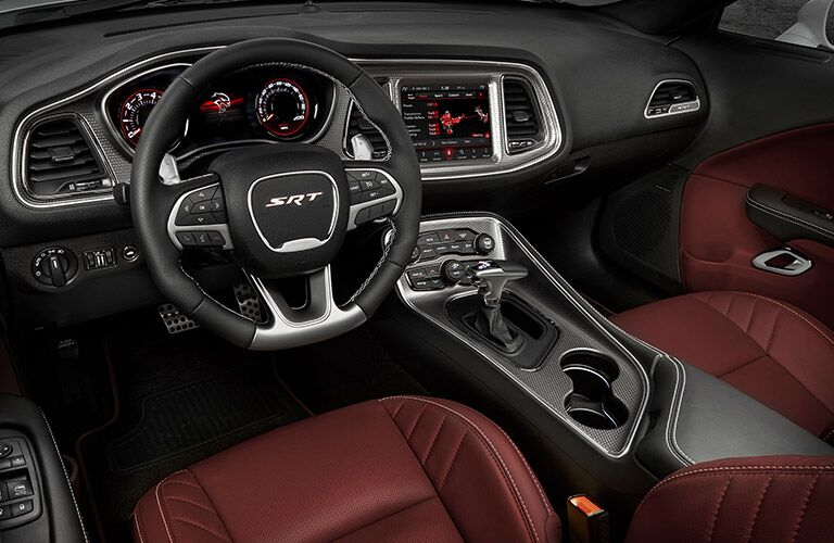 front interior of 2019 dodge challenger including steering wheel and infotainment system