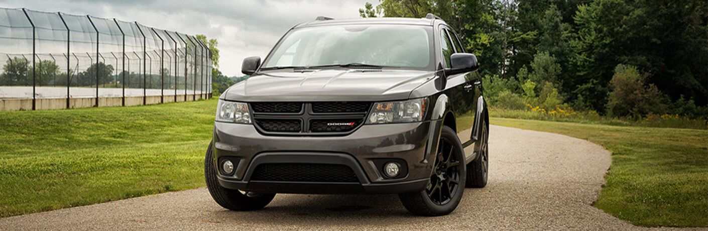 front of a black 2019 Dodge Journey