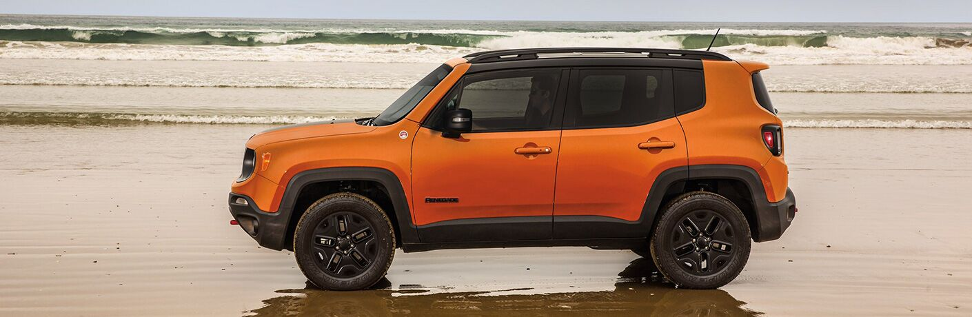 side view of an orange 2019 Jeep Renegade