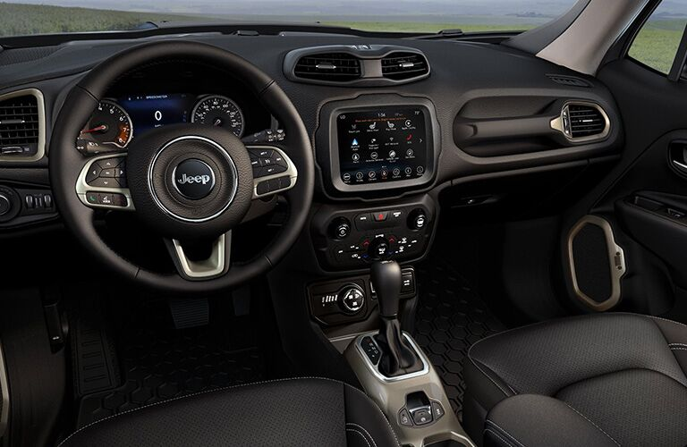 steering wheel and infotainment system of the 2019 Jeep Renegade