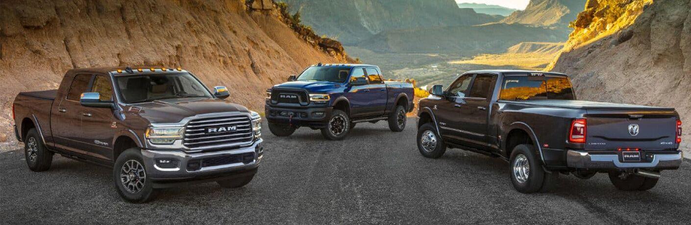 three 2019 Ram 2500 pickups on mountainous terrain