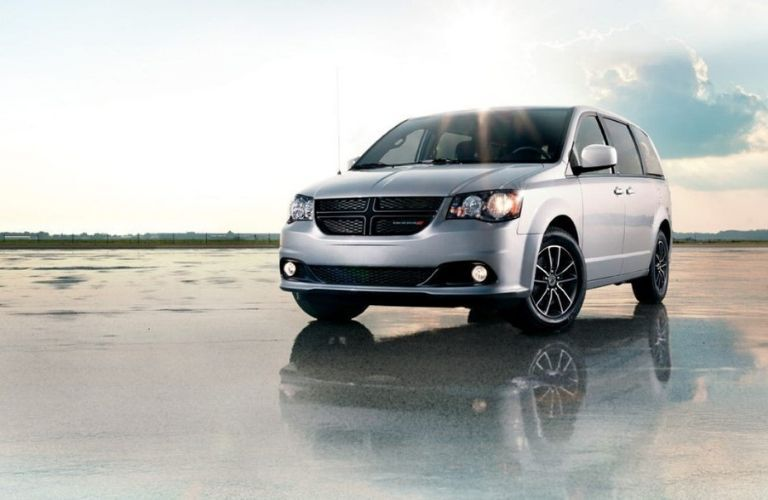 2020 Dodge Grand Caravan on rain slicked pavement
