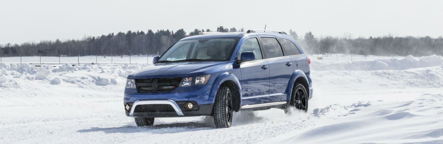 Blue 2020 Dodge Journey in snow