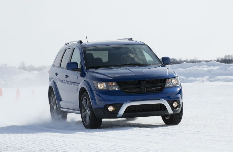 Front view of blue 2020 Dodge Journey on snow