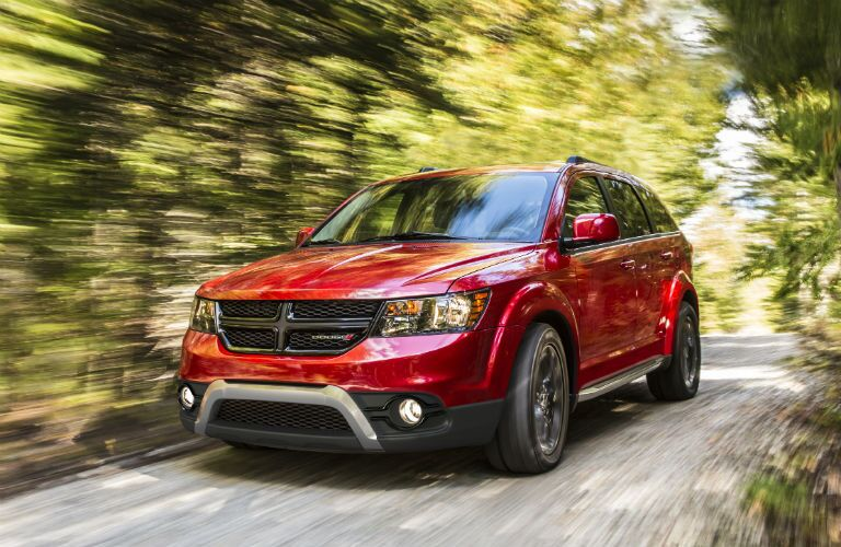 Red 2020 Dodge Journey Driving