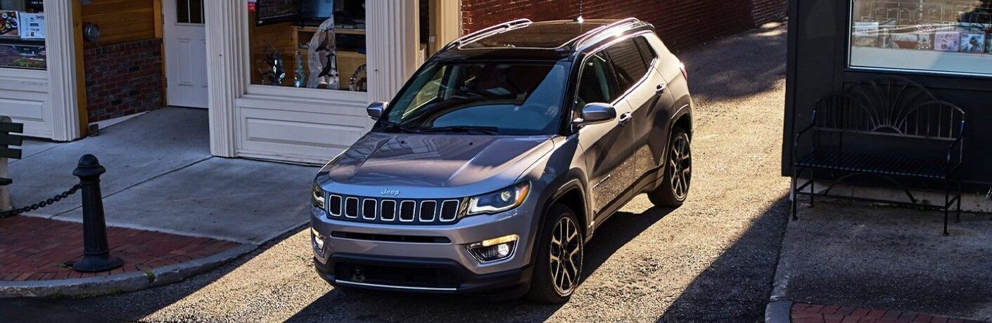 2021 Jeep Compass emerging from alleyway