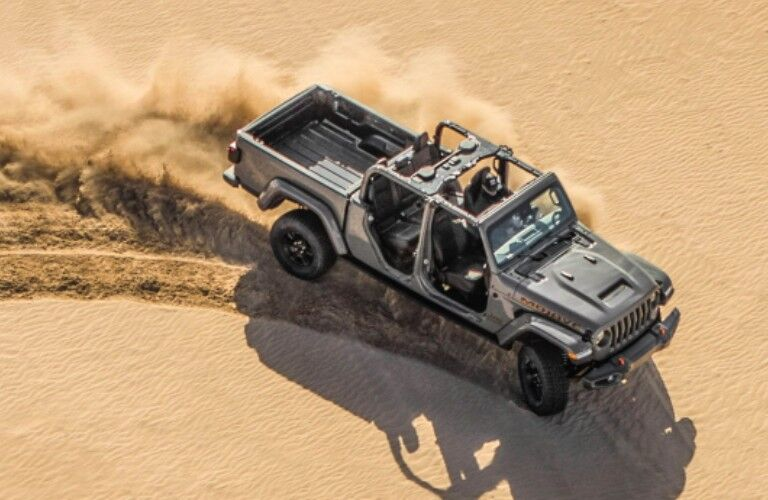 2021 Jeep Gladiator driving over sand dune
