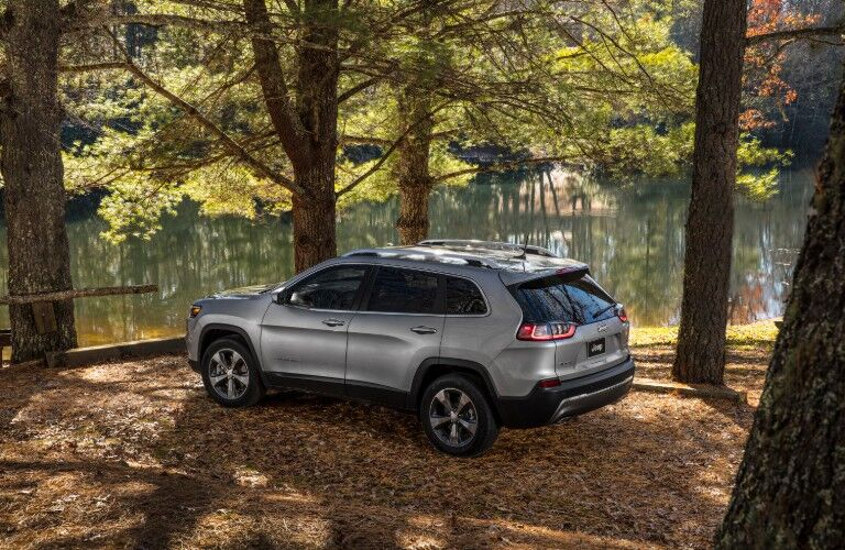2021 Jeep Cherokee parked in front of lake