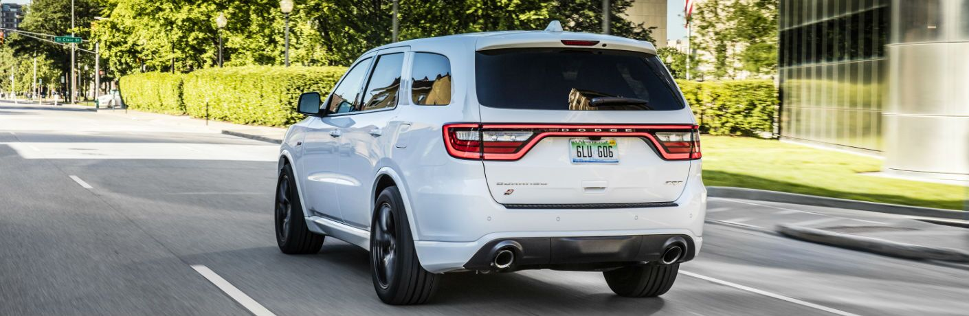 A rear quarter photo of the 2019 Dodge Durango on the road.