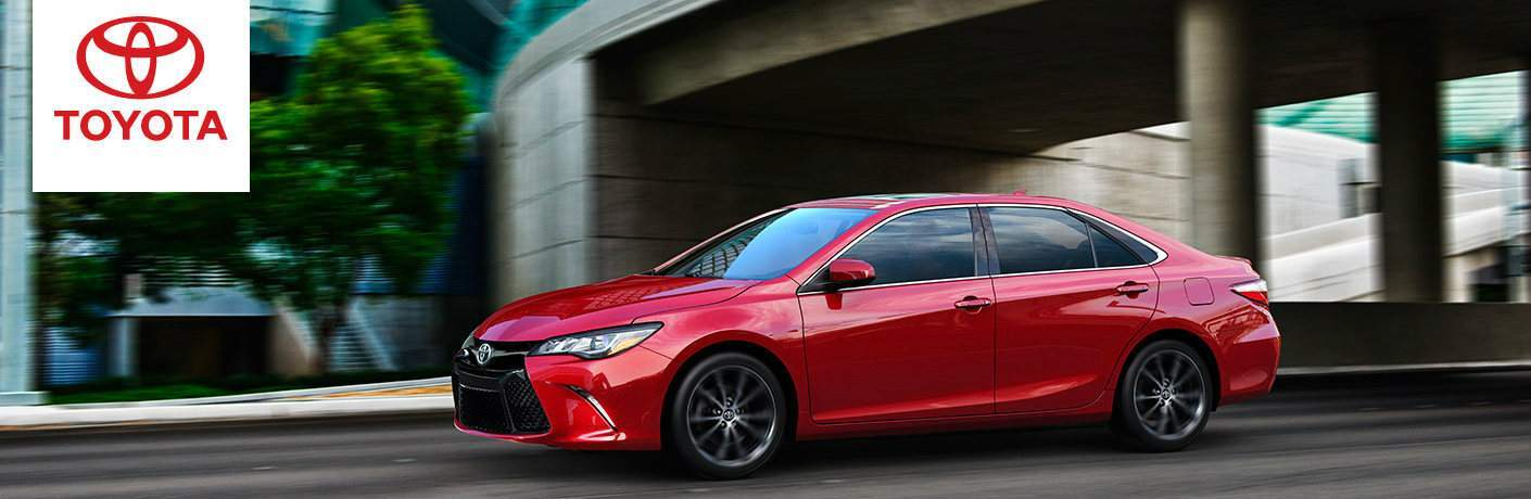 2016 Toyota Camry in red driving down a blurred street