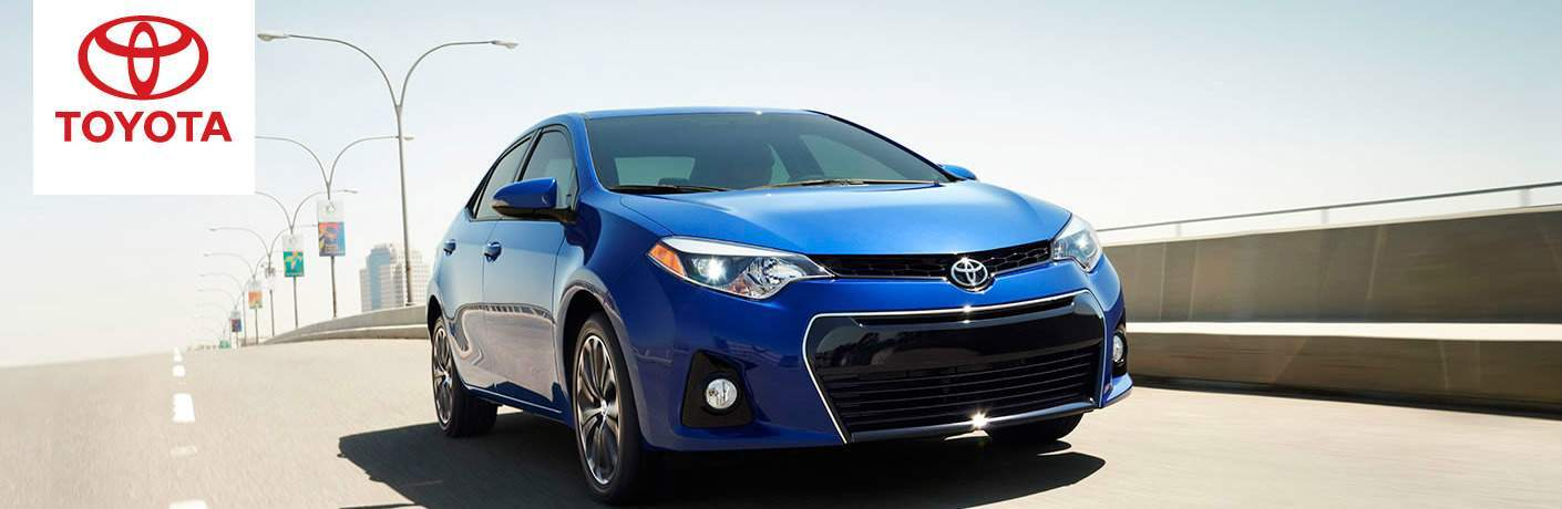 2016 Toyota Corolla in blue driving on the highway