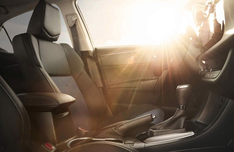 Sun shining into the front seats of the 2016 Toyota Corolla
