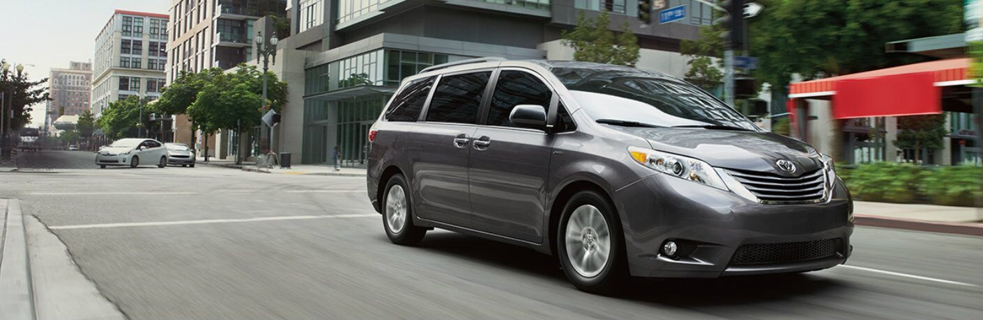 2016 Toyota Sienna minivan in grey driving on a city street