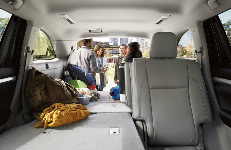 2016 Toyota Highlander cargo space with some of the rear seats folded flat