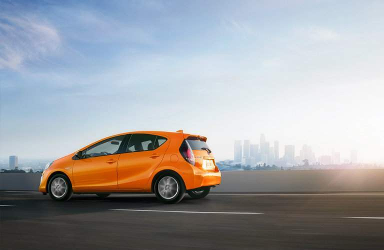 2016 Toyota Prius in orange driving on the highway