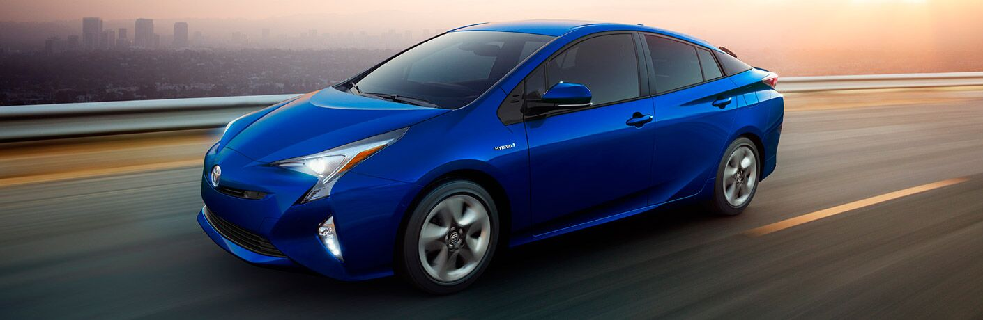 2017 Toyota Prius in bright blue driving on the highway