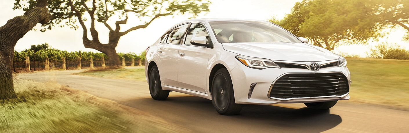 2016 Toyota Avalon in white driving near a vineyard