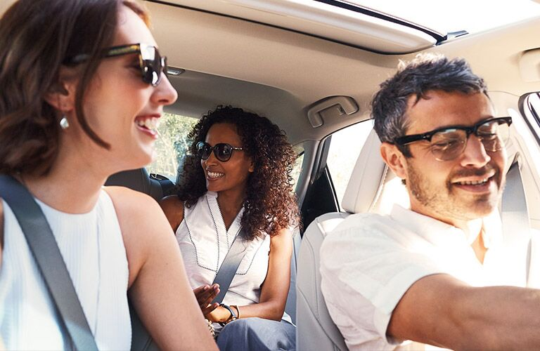 Passengers relaxing in the 2016 Toyota Avalon