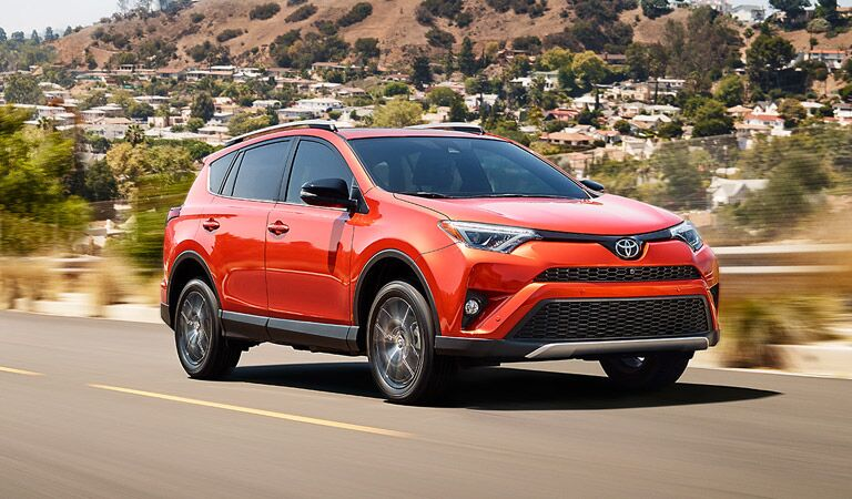 2017 Toyota RAV4 driving down a road in the desert