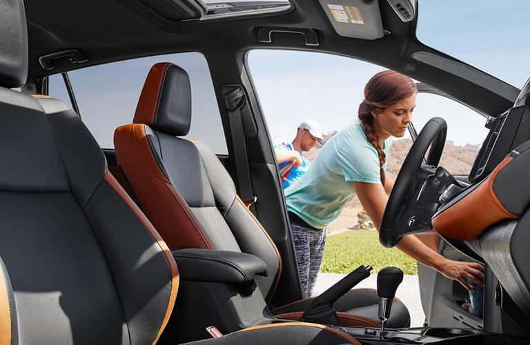 Someone reaching into the 2018 Toyota RAV4 front the driver side door