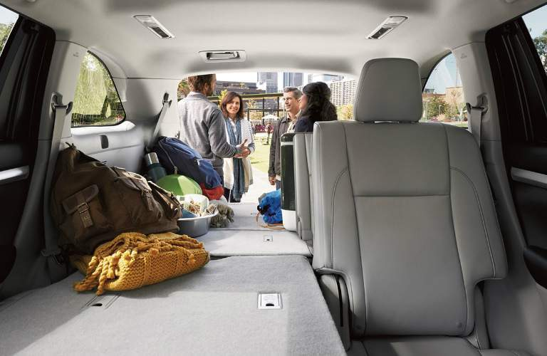 2018 Toyota Highlander Hybrid cargo space with some of the rear seats folded flat