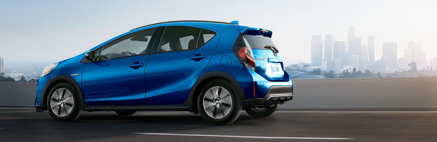 2019 Toyota Prius c in blue side profile
