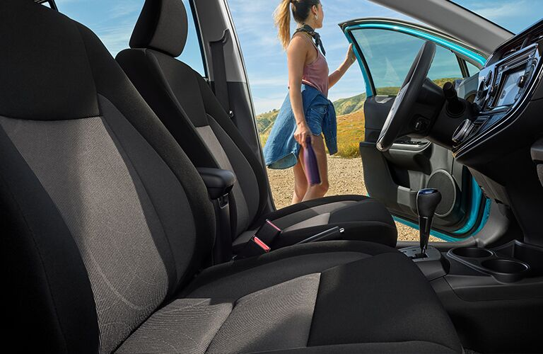 woman closing the driver's door of the 2019 Toyota Prius c