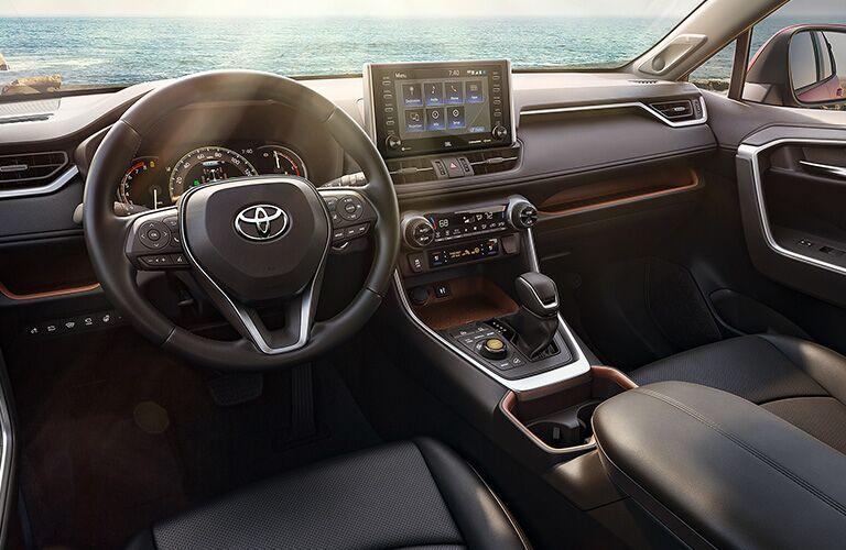 wheel and center console of 2019 Toyota RAV4 Hybrid