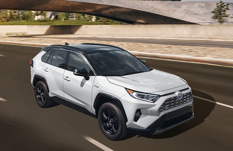 2019 Toyota RAV4 Hybrid driving down highway