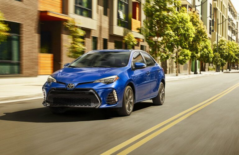 2019 Toyota Corolla in blue driving on a city street