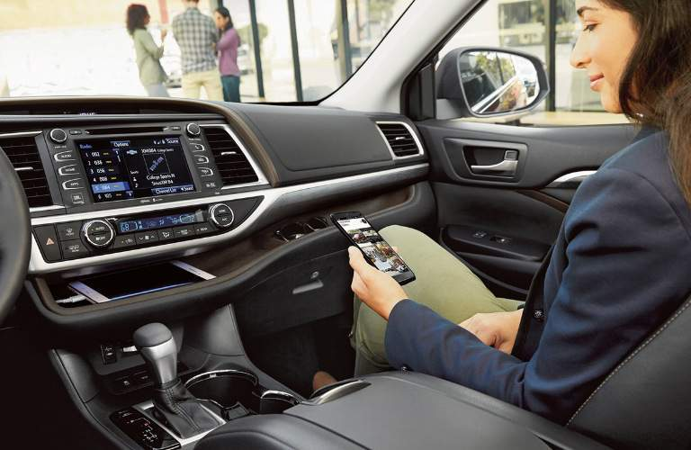 2018 Toyota Highlander front passenger looking at their phone