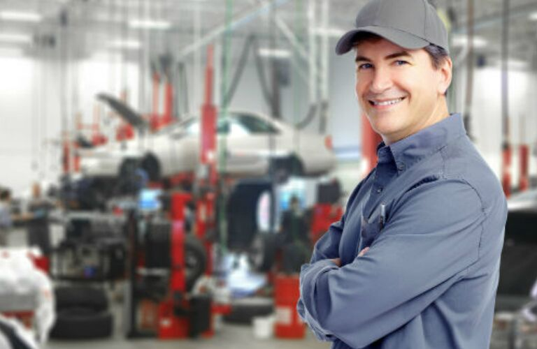 auto mechanic standing in a service center