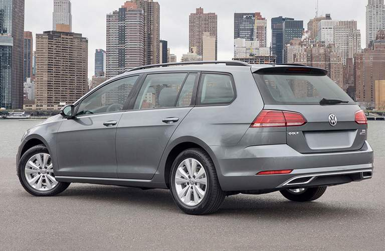 gray 2018 VW Golf SportWagen in front of city skyline exterior rear driver side view