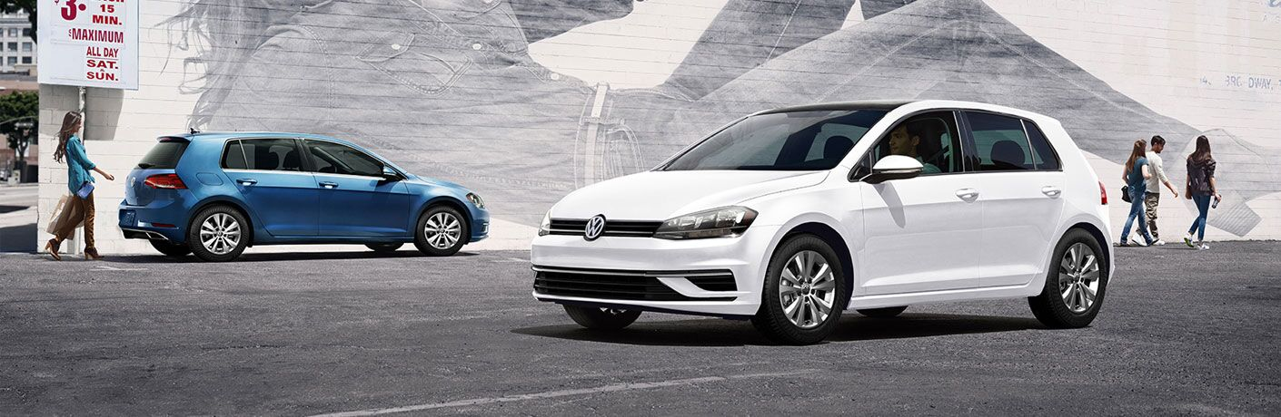 Two 2020 Volkswagen Golf hatchbacks parked next to each other