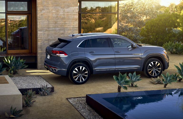 2020 Volkswagen Atlas Cross Sport parked next to a house