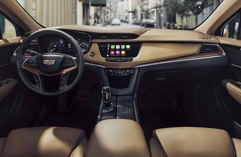 front interior of 2018 cadillac xt5 including dashboard, steering wheel, and center infotainment system