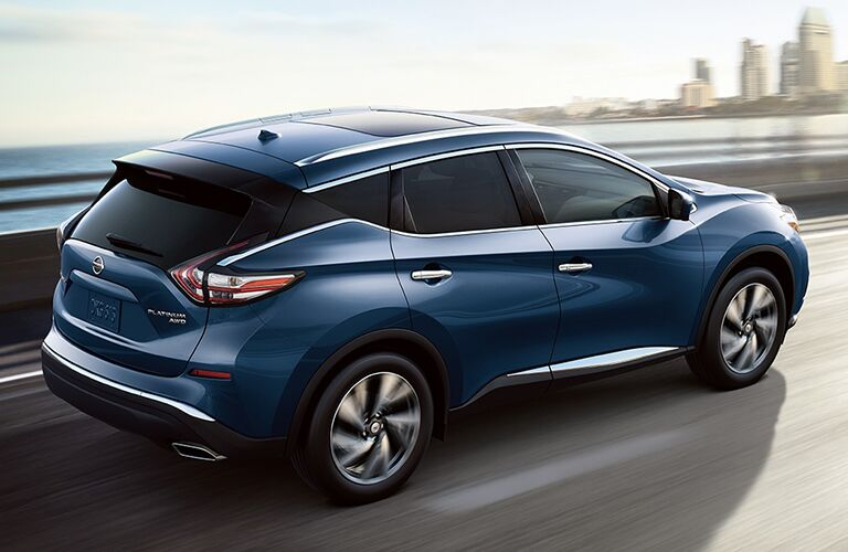 rear view of blue 2018 nissan murano driving over bridge