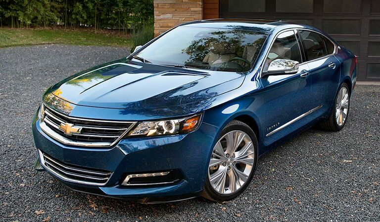 front and side view of blue 2018 chevrolet impala