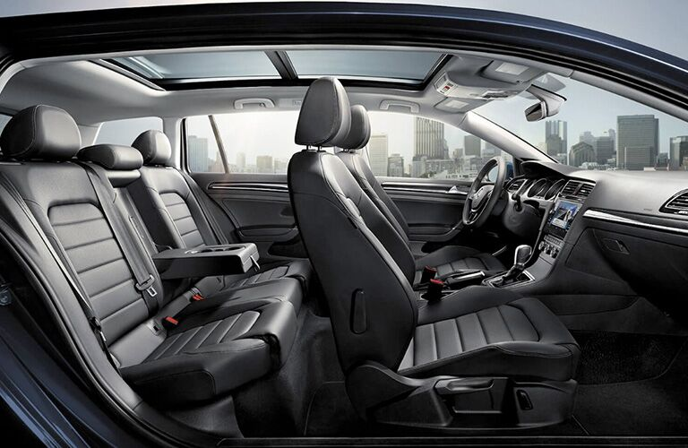 Interior view of 2018 Volkswagen Golf SportWagen showing both rows of black seating and steering wheel