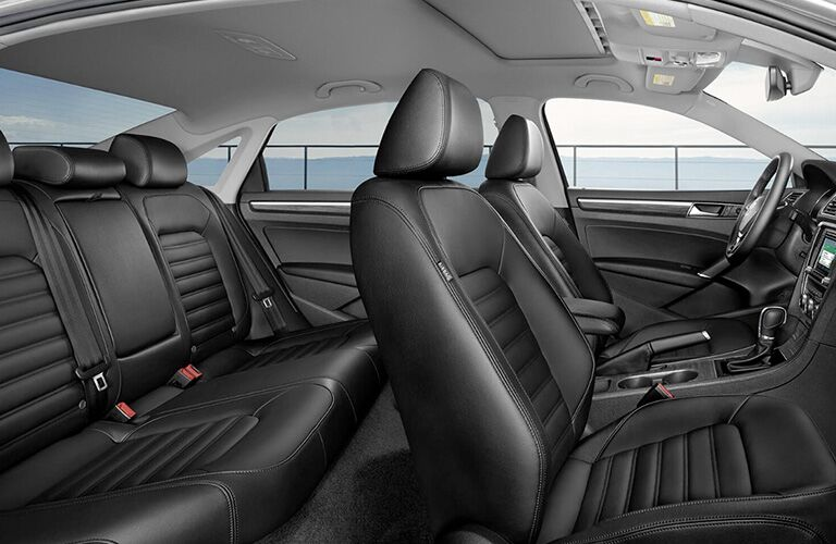 Interior view of a 2018 Volkswagen Passat showing black seating in front and back