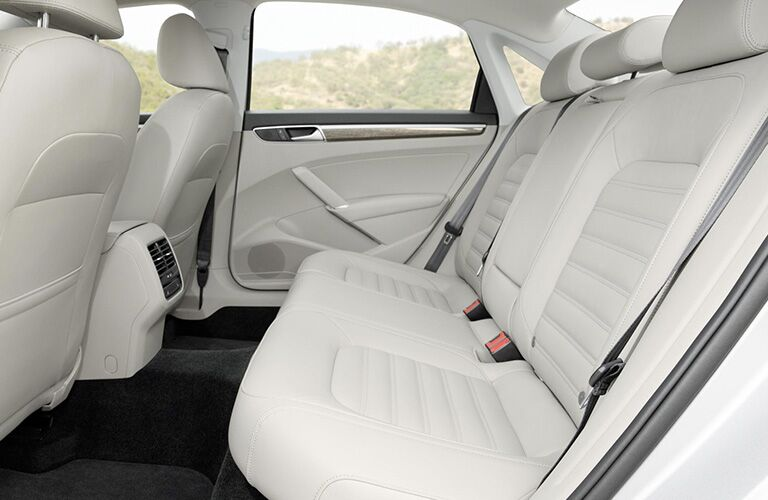Interior view of the rear tan seating of a 2018 Volkswagen Passat