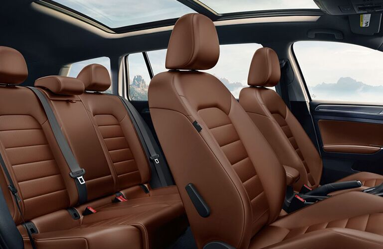 Interior view of a 2018 Volkswagen Golf Alltrack showing the brown front and rear rows of seating