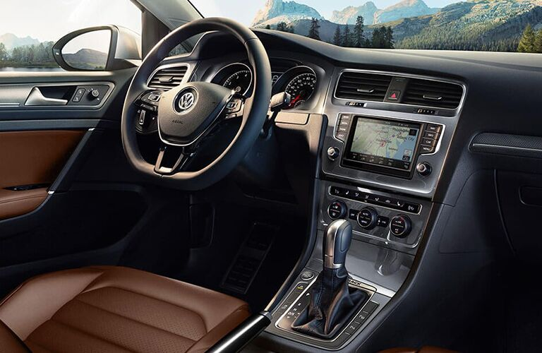 Interior view of a 2018 Volkswagen Golf Alltrack showing the brown seating, steering wheel and touchscreen