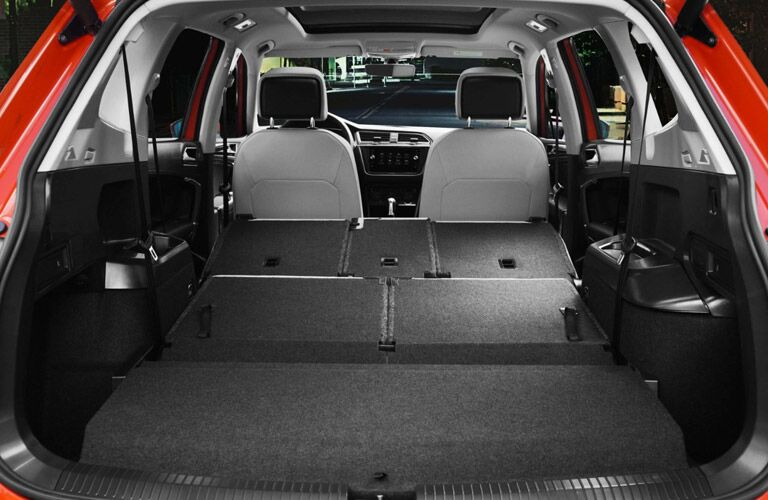 Interior view of the second and third row of seating folded flat inside a 2018 Volkswagen Tiguan