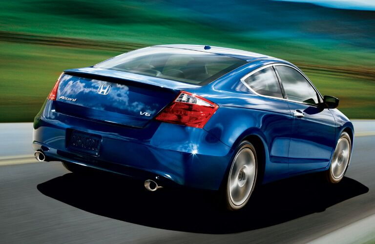 blue 2009 Honda Accord exterior rear driving down highway