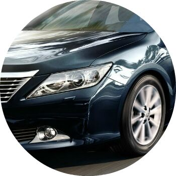 2012 Toyota Camry headlight and front tire