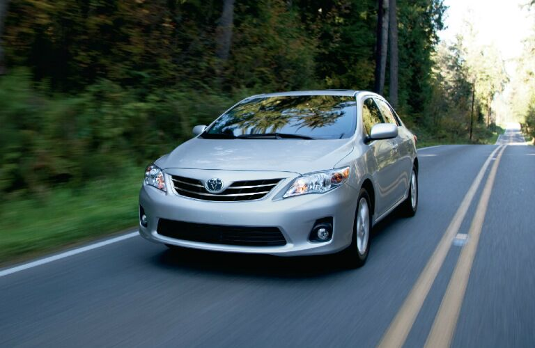 2012 Toyota Corolla driving down highway